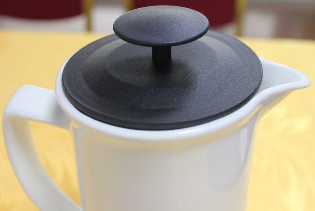white ceramic coffee press